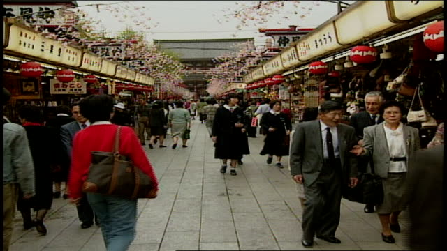 crowded street market in asakusa kannon temple japan - shitamachi stock videos and b-roll footage