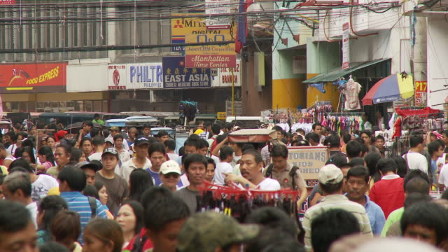 crowded street of shoppers in manila philippines - philippines stock videos & royalty-free footage
