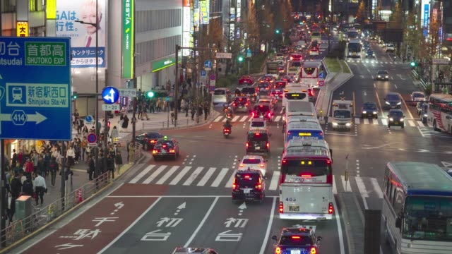crowded street of the district of shinjuku - bus billboard stock videos & royalty-free footage