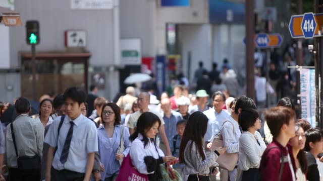 crowded streets of tokyo, japan - abundance stock videos & royalty-free footage