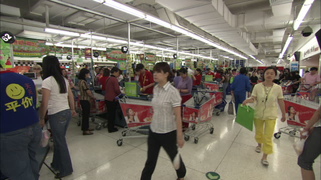 ws crowded supermarket scene, beijing, china - checkout stock videos & royalty-free footage