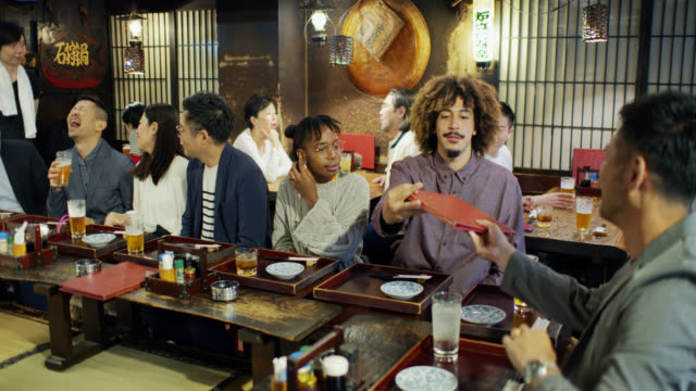 crowded tokyo bar at happy hour - multiracial group stock videos & royalty-free footage