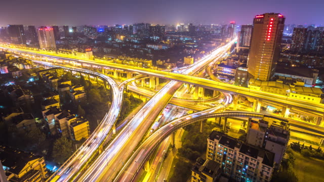 crowded traffic on road junction in modern city. time lapse - hangzhou stock videos & royalty-free footage