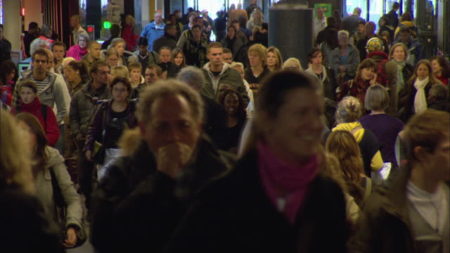 ms selective focus crowded train station with digital departure board / amsterdam, holland - station stock videos & royalty-free footage
