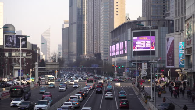 vídeos de stock, filmes e b-roll de crowded urban traffic and exhaust emissions are considered to be one of the major causes of air pollution in northern china esp beijingtianjin and... - produto interno bruto