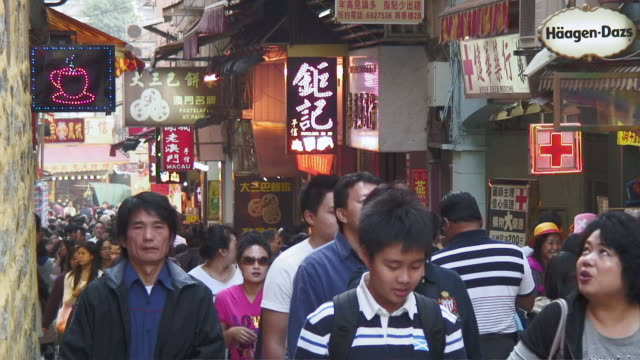 MS Crowded walkway in street / Macau, China