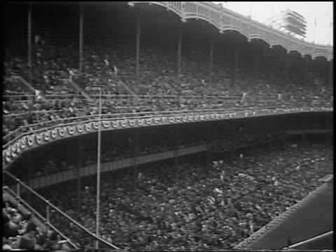 crowded yankee stadium during world series / nyc / newsreel - 1956 stock-videos und b-roll-filmmaterial