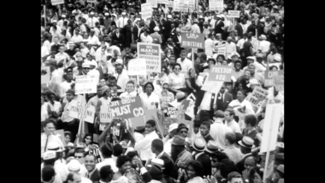 vídeos de stock e filmes b-roll de / crowds and demonstrators at the march on washington signs and placards march on washington begins on august 28 1963 in washington dc - 1963