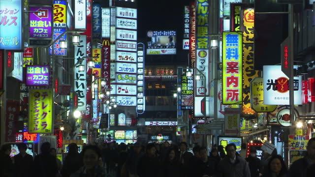 WS Crowds and neon signs in Shinjuku, Tokyo, Japan