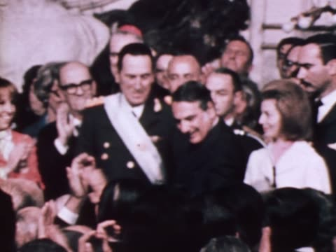 Crowds applaud as Juan Peron receives insignia of office