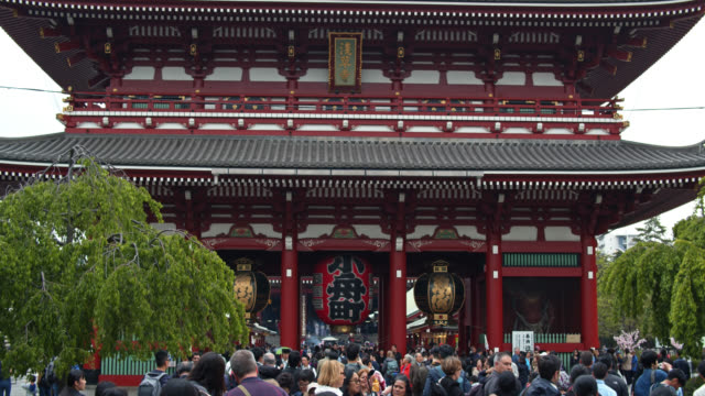 crowds approaching kaminarimon by sensō-ji - buddhism stock videos & royalty-free footage