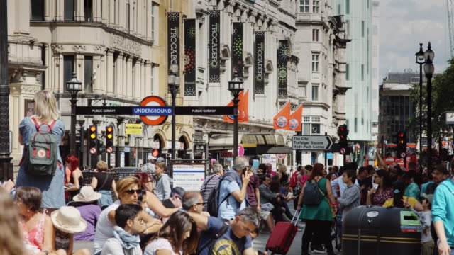 crowds around piccadilly circus station - busy stock videos & royalty-free footage