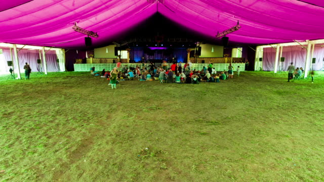 Crowds arriving in tent at start of days entertainment to UK music Festival