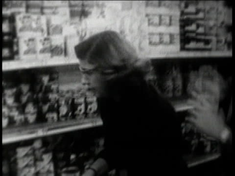 crowds at a food market / woman grabbing canned goods from a shelf / empty shelves / shopping cart full of food / cash register ringing up items - cuban missile crisis stock videos & royalty-free footage