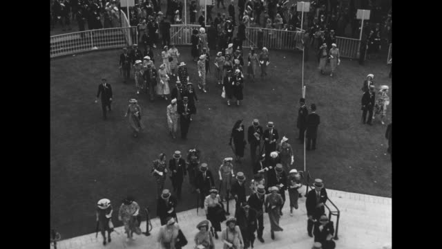 crowds at ascot racecourse prior to running of the ascot stakes / racing fans enter enclosure / montage royal carriage bearing king george vi and... - enclosure stock videos & royalty-free footage