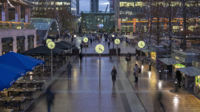 crowds at canary wharf at dusk - clock stock videos & royalty-free footage