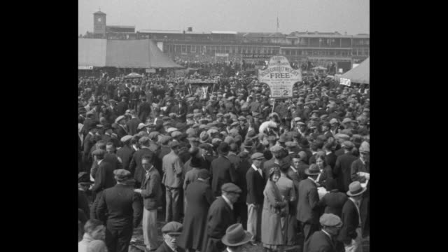 """crowds at midway area of doncaster racecourse for the st. leger stakes horse race, with tents in background and side and sign touting """"your correct... - documentary footage stock videos & royalty-free footage"""