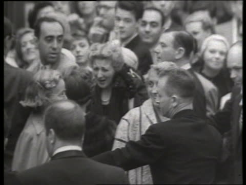 b/w 1954 crowds at movie premiere of thunder bay / no sound - 1954 stock videos & royalty-free footage