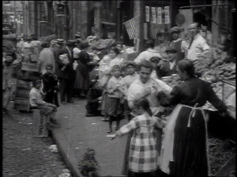 stockvideo's en b-roll-footage met 1915 ms crowds at new york city lower east side market / new york united states - 1915