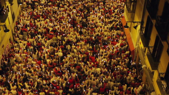 ws tu aerial crowds at pobre de mi closing ceremony of festival of san fermin / pamplona, navarre, spain - government building stock videos and b-roll footage