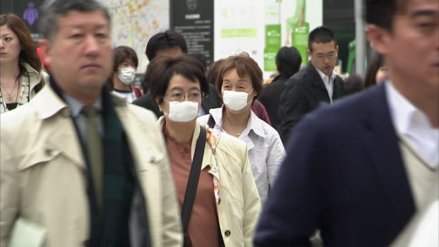 ms zo selective focus crowds at shibuya, tokyo, japan - pollution mask stock videos and b-roll footage