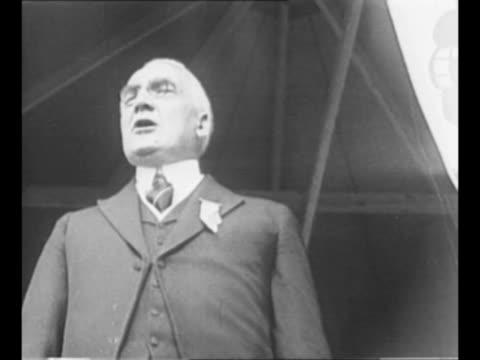 ws crowds at tercentenary pageant of pilgrim landing at plymouth rock tent pavilion stands in background / us president warren g harding speaks at... - pellegrino video stock e b–roll