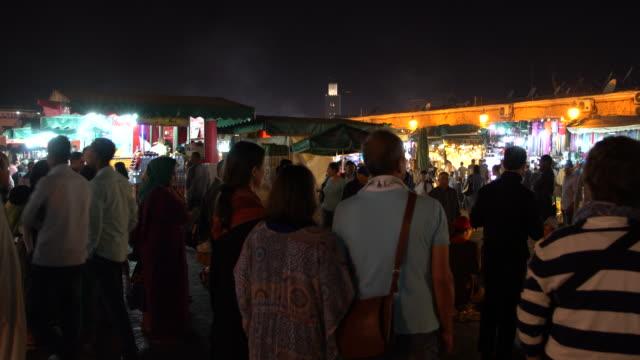 Crowds at the Jamaa el Fna square at night, Marrakech, Morocco