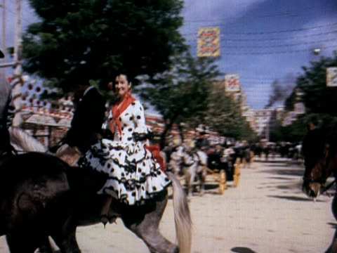 1960 montage crowds at traditional celebration in spanish town - religious dress stock videos & royalty-free footage