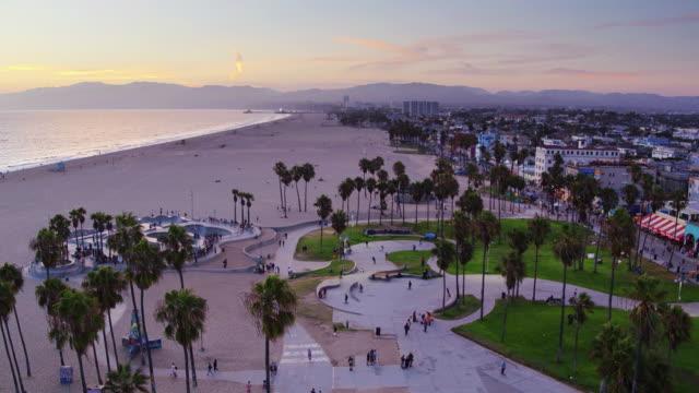 Crowds at Venice Beach Skate Park at Sunset - Drone Shot
