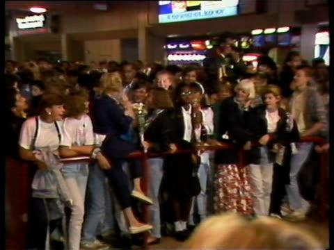 crowds await madonna's arrival at heathrow airport - マドンナ点の映像素材/bロール