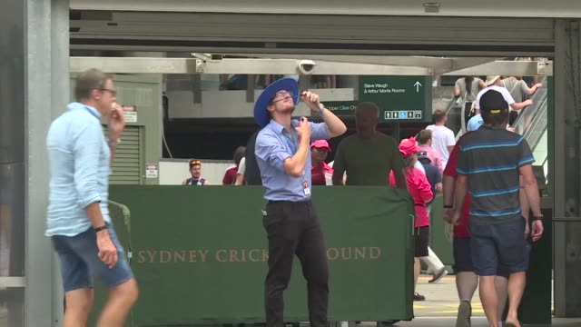 Crowds battle hot temperatures outside the Sydney Cricket Ground on the final day of the fifth Ashes Test against Australia a day after one of the...