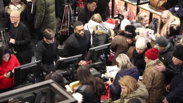 crowds brave freezing temperature as they race for black friday bargains at a macy's department store in midtown manhattan - black friday stock videos & royalty-free footage