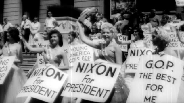 crowds carrying picket signs reading 'young republicans first' 'rocky means victory' and 'we have a convention not a coronation' / governor nelson... - partito repubblicano degli usa video stock e b–roll