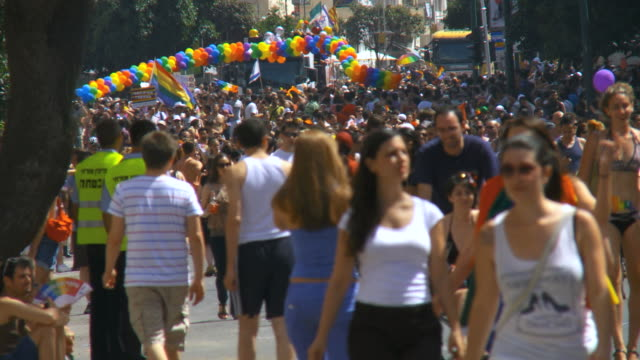 MS Crowds celebrate and dance at gay pride in streets / Tel Aviv, Israel