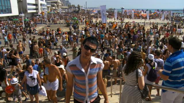 ws pan crowds celebrate gay pride in beach / tel aviv, israel  - tel aviv stock videos & royalty-free footage