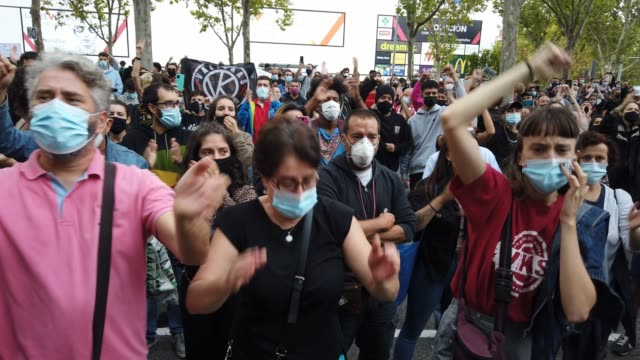 crowds chant a slogan and clap together during a demonstration, in the vallecas neighborhood, against the measures imposed by the capital's regional... - number 2 stock videos & royalty-free footage