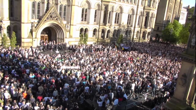 crowds chanting manchester outside manchester town hall in a show of togetherness and defiance after the manchester arena bombing - manchester arena stock videos & royalty-free footage
