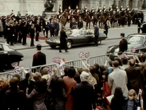 Crowds cheer and wave flags as the Queen and Prince Philip arrive at the City Hall in Paris during her state visit to France 1972
