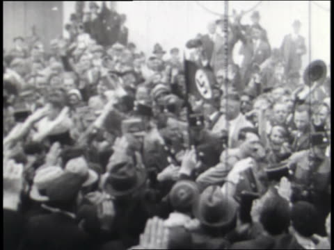 crowds cheer hitler; german currency is super-imposed over a market; german troops march. - nazism stock videos & royalty-free footage