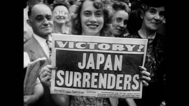 / crowds cheering on the streets of chicago on vj day / woman holds newspaper up to camera that reads: 'victory! japan surrenders'. crowds... - allied forces stock videos & royalty-free footage