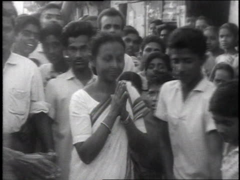 crowds cheering / people with banners in the streets / indira gandhi walking with men - indira gandhi stock videos & royalty-free footage