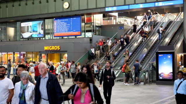 crowds, commuters  and rush at train station/basel, switzerland, europe. - switzerland stock videos & royalty-free footage