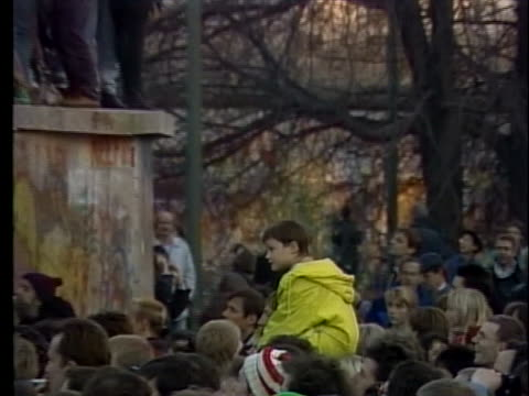 crowds continue to celebrate after the berlin wall falls. - 1989 stock videos & royalty-free footage