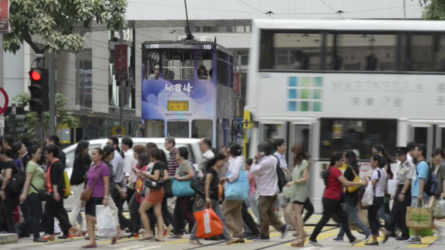 crowds crossing des voeux road.central shopping district. - no parking sign stock videos & royalty-free footage