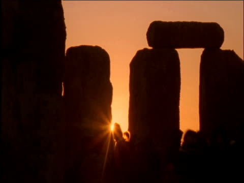 Crowds enjoy Summer solstice sunrise at Stonehenge