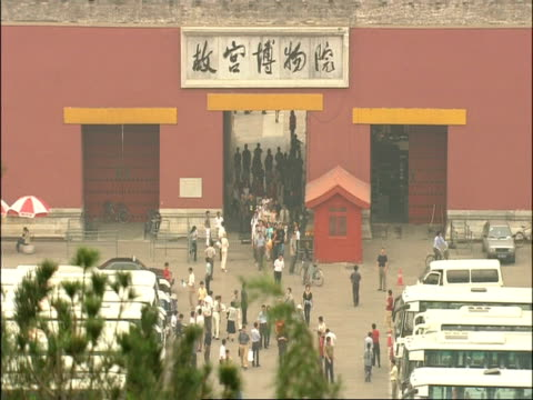 crowds exiting from forbidden city through meridian gate, beijing, china - empire stock videos & royalty-free footage