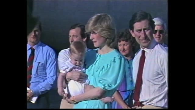crowds ext alice springs airport terminal bright blue skies / raaf royal jet lands / crowds / official party stand on tarmac / prince charles and... - 1983 stock videos & royalty-free footage