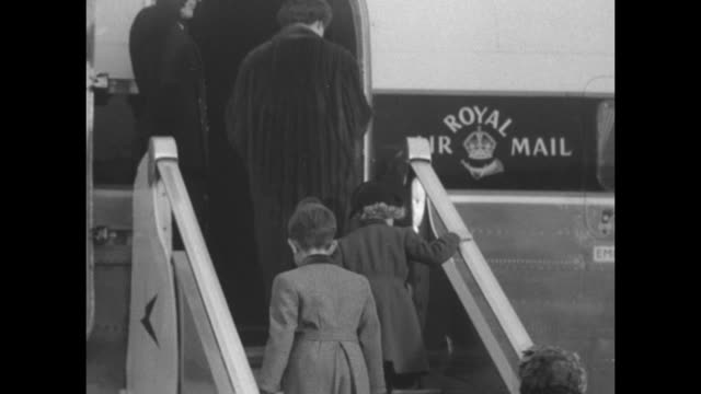 crowds fill the observation deck at heathrow airport / various shots of queen elizabeth ii reviewing british troops / pan of nigerian people looking... - documentary footage stock videos & royalty-free footage