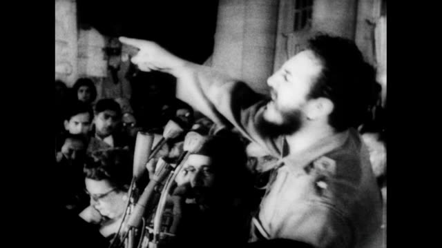 vídeos de stock e filmes b-roll de / crowds fill the streets in cuba / fidel castro speaks passionately to the crowd fidel castro and the invasion of cuba on april 17 1961 in cuba - 1961