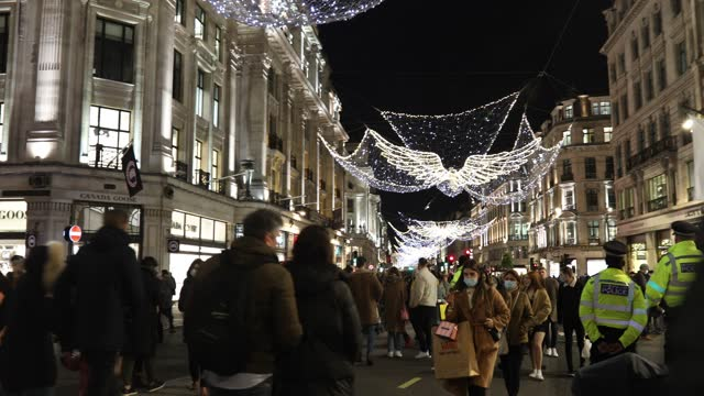 crowds fill the streets shopping on oxford street and regent street decorated in holiday lights during the first weekend after lockdown on december... - weekend activities stock videos & royalty-free footage